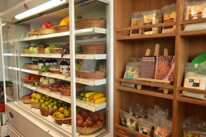 Fresh vegetables and grocery items at the I Say Organic store